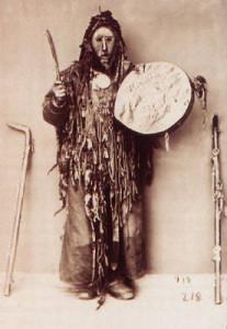 shaman_in_ritual_costume_with_tambourine